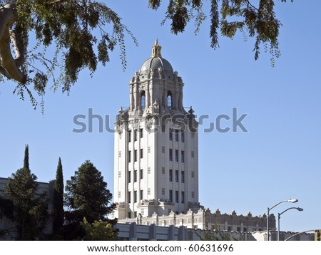 Beverly Hills City Hall building with overhead foliage.