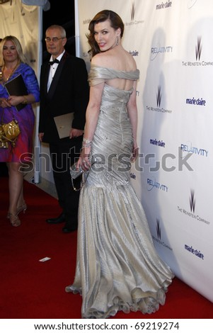 BEVERLY HILLS - JAN 16: Milla Jovovich arrives at The Weinstein Company And Relativity Media\'s 2011 Golden Globe Awards Party at Beverly Hilton Hotel on January 16, 2011 in Beverly Hills, CA