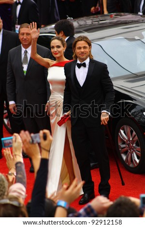 BEVERLY HILLS - JANUARY 15: Actors Angelina Jolie and Brad Pitt arriving to the Beverly Hilton Hotel for the 69th annual Golden Globe Awards ceremony January 15, 2012 Beverly Hills, CA.