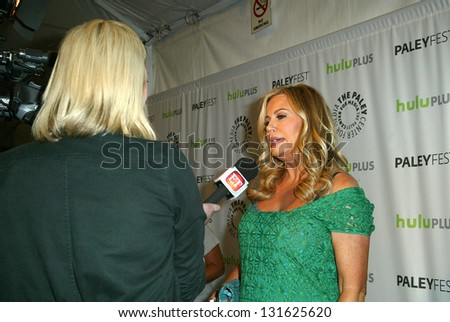 BEVERLY HILLS - MARCH 14: Jennifer Coolidge is interviewed by the media at the 2013 Paleyfest \