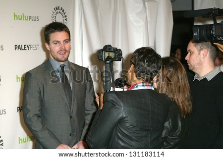 BEVERLY HILLS - MARCH 9: Stephen Amell in interviewed by the media at the 2013 Paleyfest \