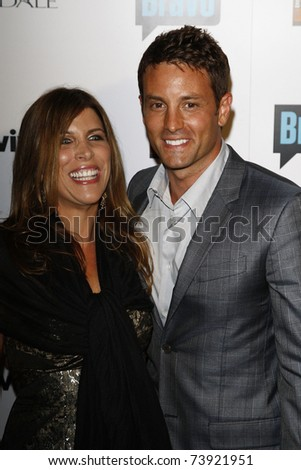 BEVERLY HILLS - OCT 11:  Nick Stabile and wife at the Bravo's 'The Real Housewives of Beverly Hills' series party at Trousdale, Beverly Hills, California on October 11, 2010. - stock photo