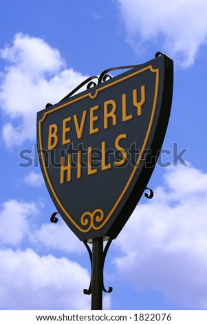 Beverly Hills sign in Hollywood, Los Angeles against a blue cloudy sky