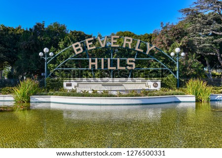 Beverly hills sign in Los Angeles park in Los Angeles, USA. The Beverly Hills Shield greets visitors along Santa Monica Blvd. #1276500331