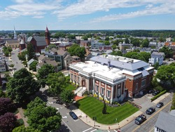 Beverly Public Library aerial view at 32 Essex Street with Cabot Street at the background in historic city center of Beverly, Massachusetts MA, USA.
