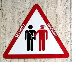 Beware of pickpockets sign security warning, train station platform, Italy