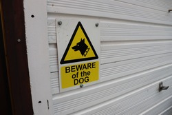 Beware of the dog property sign
