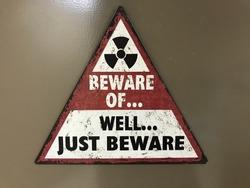 BEWARE OF...WELL...JUST BEWARE metal sign on office door.