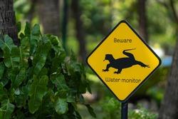Beware water monitor or varanus salvator sign in park.