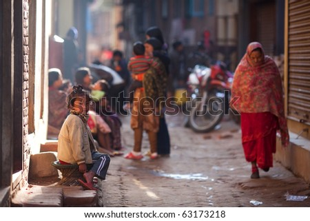 BHAKTAPUR, NEPAL - JANUARY 08: An unidentified nevari girl on the busy street in old town on January 08, 2010 in Bhaktapur, Kathmandu valley, Nepal.
