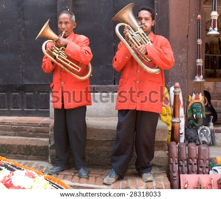 BHAKTAPUR, NEPAL - MAY 8: A pair of nepalese street musicians playing on brass trumpet in Bhaktapur, Nepal, on May 8, 2008. Bhaktapur is located about 20 km east of Kathmandu.
