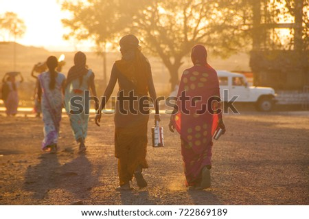 BHIWAPUR, NAGPUR, MAHARASHTRA, INDIA 13 FEBRUARY 2016 : Unidentified rural woman worker return from the farm at sunset. daily lifestyle in rural India. #722869189
