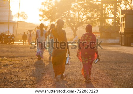 BHIWAPUR, NAGPUR, MAHARASHTRA, INDIA 13 FEBRUARY 2016 : Unidentified rural woman worker return from the farm at sunset. daily lifestyle in rural India. #722869228