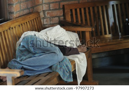 BHOPAL- DECEMBER 6: A Bhopal gas disaster survivor sleeping on a chair after getting tired of waiting for medicine from a clinic dedicated to the gas victims in Bhopal - India on December 6, 2010.
