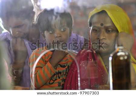 BHOPAL- DECEMBER 6: A mother along with her child waiting to get  medicine from a clinic dedicated to the Bhopal gas survivors and their families in Bhopal - India on December 6, 2010.