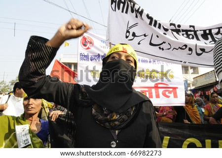 BHOPAL- DECEMBER 3: A Muslim woman chants slogans during the rally to mark the 26th Year of the Bhopal Gas Disaster in Bhopal - India on December 3, 2010.