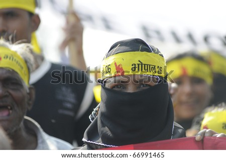 BHOPAL- DECEMBER 3 : A Muslim woman in burkha,during  a rally to mark the 26th year of the Bhopal gas disaster, in Bhopal - India on December 3, 2010.