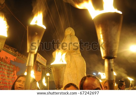 BHOPAL- DECEMBER 2: Activists  in front of the Bhopal Mother Statue  during the torch rally organized to mark the 26th year of Bhopal gas disaster, in Bhopal - India on December 2, 2010.