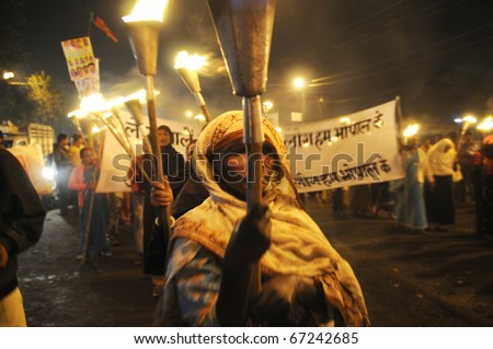 BHOPAL- DECEMBER 2: An old woman participate in the protest during the torch rally organized to mark the 26th year of Bhopal gas disaster, in Bhopal - India on December 2, 2010. - stock photo