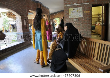 BHOPAL- DECEMBER 6: Bhopal gas survivors lined up to get medicine from a clinic dedicated to the Bhopal gas victims  in Bhopal - India on December 6, 2010.