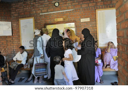 BHOPAL- DECEMBER 6:  Bhopal gas victims of all ages waiting in a corridor of clinic dedicated towards the gas victims to get medicine in Bhopal - India on December 6, 2010.