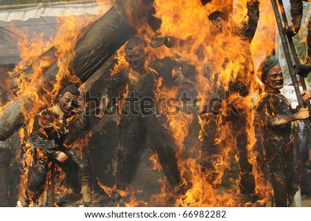 BHOPAL- DECEMBER 3: Close up of the burning effigy during the rally to mark the 26th Year of the Bhopal Gas Disaster in Bhopal - India on December 3, 2010.