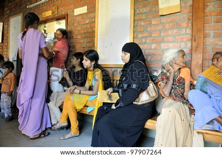 BHOPAL- DECEMBER 6:  in Bhopal -Three generation of the Bhopal gas disaster survivors waiting in a corridor of a free clinic in India on December 6, 2010.