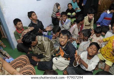 BHOPAL- DECEMBER 2:  Patients of a clinic for Bhopal victims enjoying during a children's day celebration in Bhopal - India on December 2, 2010.
