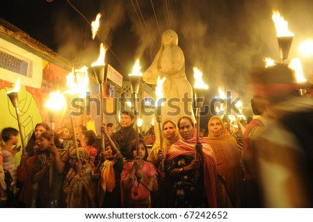 BHOPAL-DECEMBER 2: Protesters gather after the march near the Union Carbide plant during the torch rally organized to mark the 26th year of Bhopal gas disaster, in Bhopal -India on December 2,2010.