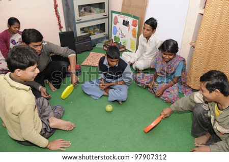 BHOPAL- DECEMBER 7:  3rd generation victims of the Bhopal gas disaster playing in a rehabilitation clinic in Bhopal - India on December 7, 2010.