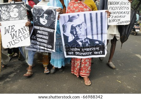 BHOPAL-DECEMBER 2: Victims walk with an image of Warren Anderson and asking for his extradition during the rally to mark the 26th year of Bhopal Gas Disaster, in Bhopal - India on December 2,2010.