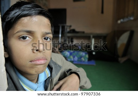 BHOPAL- DECEMBER 7:  11 years old Azhar suffering from cerebral palsy waiting eagerly inside a clinic for his ride to his home in  Bhopal - India on December 7, 2010.