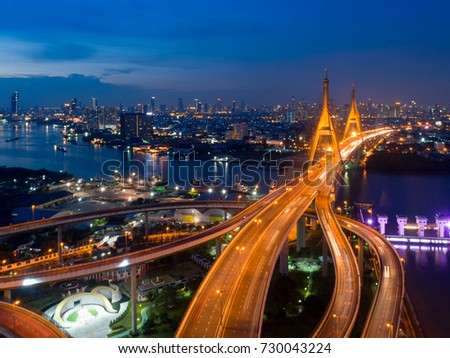 Bhumibol bridge , Bangkok Expressway and Highway top view during twilight time ,expressway is an important infrastructure for rush hour in Bangkok , Bangkok,Thailand #730043224