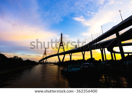 Bhumibol Bridge (The Industrial Ring Road Bridge) in the evening at Samut Prakan, Thailand. (Silhouette) #362356400