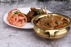 Bhuna Gosht Mutton masala OR Indian Lamb masala and mutton curry Served with onion over moody background.