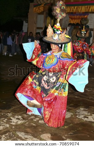BHUTAN - APRIL 15: A dancer with colorful mask dances at a yearly festival called tsechu on April 15, 2008 in Bhutan