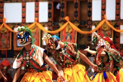 Bhutan dance(tibet dance),Close up Traditional dance and colors in Mongar, Bhutan ,masked dancers at a Buddhist religious ceremony,happy holiday