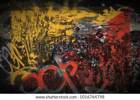 Bhutan flag painted on dirty_street_wall_with_graffity texture background #1016764798