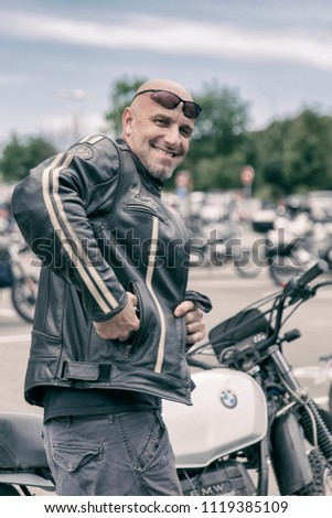 Biarritz, France-June 16,2018: Sexy biker parks his motorbike in the Wheels and Waves festival in Biarritz. #1119385109