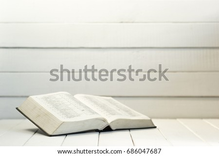 bible and the crucifix on a...