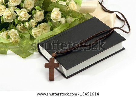 Bible, crucifix , roses on white background