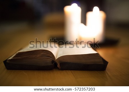 bible laid on wooden floor ...