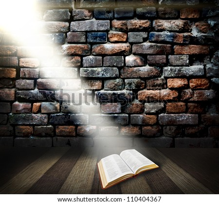 Bible on wood with Ray of light background