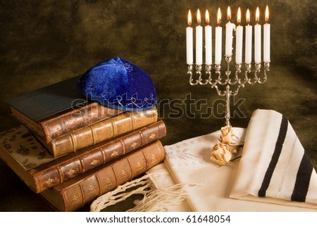 Bible, prayer shawl, jewish cap and nine candle menorah