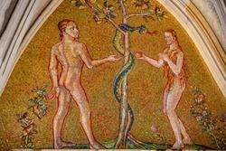 Bible scene of Genesis with Adam and Eva at major entrance portal of Saint Vitus Cathedral in Prague, Czech Republic, details, closeup