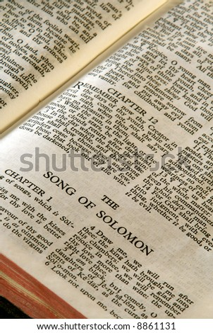 Bible Series. close up detail of antique holy bible open to the book of the song of solomon in the old testament
