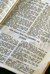 Bible Series. close up detail of antique holy bible open to the gospel according to the general epistle of john in the new testament