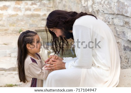Biblical scene when Jesus says, let the little children come to me, blessing a little girl. Historical reenactment at an old water well. #717104947