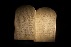 Biblical Ten Commandments inscribed on stone tablets in the Paleo-hebrew script