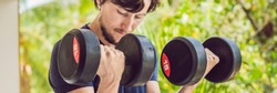 Bicep curl - weight training fitness man outside working out arms lifting dumbbells doing biceps curls. Male sports model exercising outdoors as part of healthy lifestyle BANNER, long format